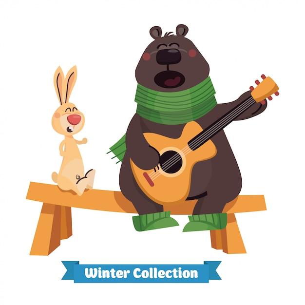 Счастливый милый бурый медведь играет на гитаре с кроликом Premium векторы
