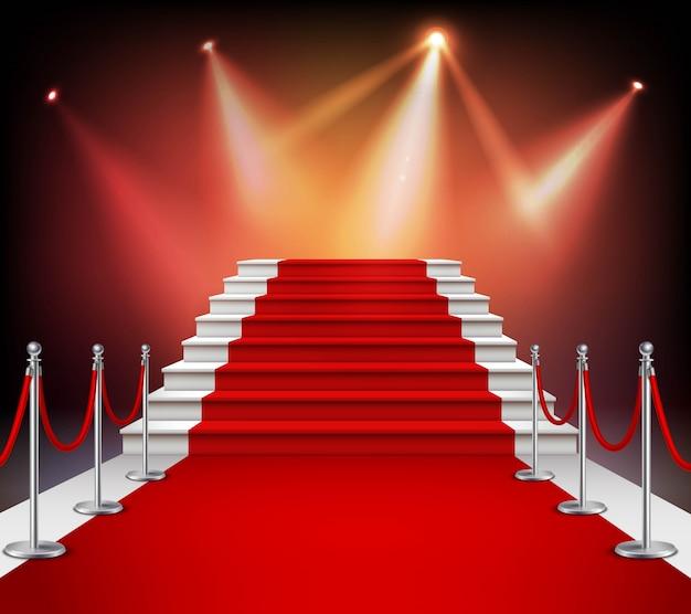 Белые лестницы, покрытые красной ковровой дорожкой и освещенные прожектором реалистичные векторные иллюстрации Бесплатные векторы