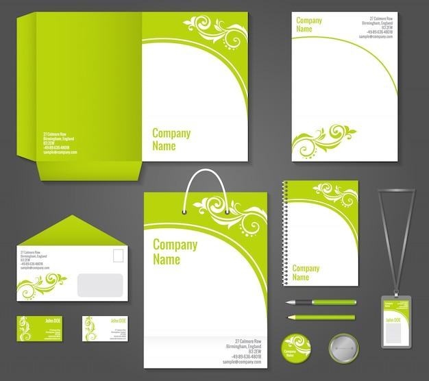 企業のアイデンティティとブランディングのベクトル図を設定するための緑の花の波状のビジネス文房具のテンプレート 無料ベクター