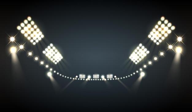 Реалистичные прожекторы на стадионе с яркими символами Бесплатные векторы