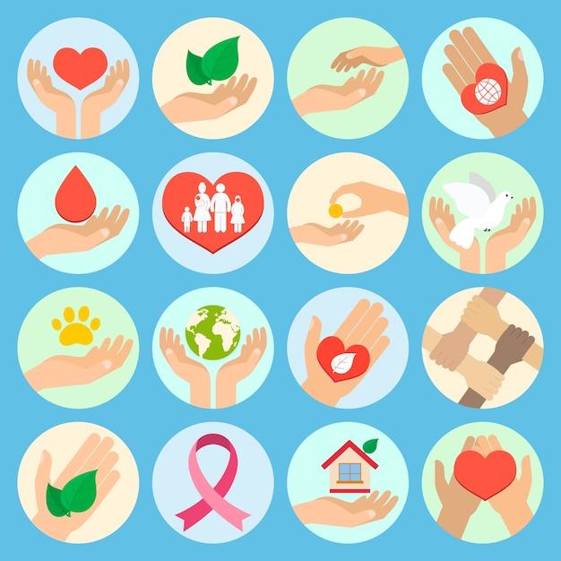 慈善団体の寄付社会サービスとボランティアのアイコンは、手で孤立したベクトル図を設定 無料ベクター