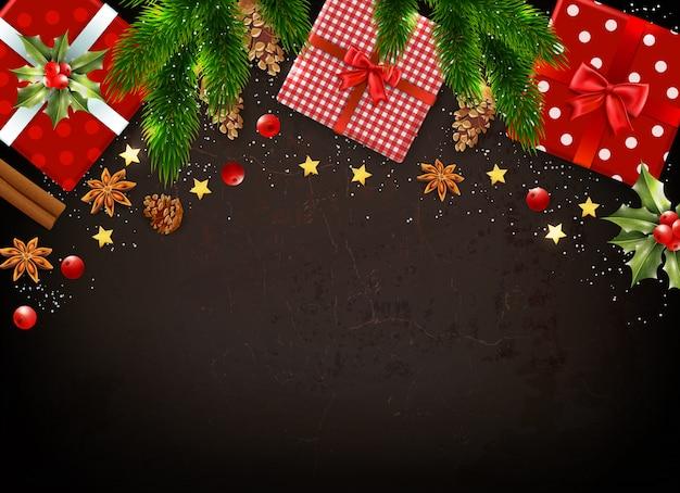 ギフトボックスヤドリギなどのさまざまなカラフルなクリスマスのシンボルと暗い背景の葉現実的なモミの木の枝 無料ベクター