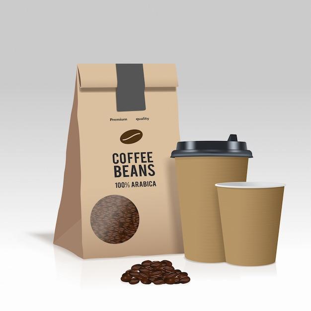 コーヒー豆と一緒に紙のコーヒーカップと茶色の紙袋を取り除きます。 Premiumベクター