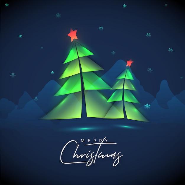 Каллиграфия с рождеством с бумагой вырезать стиль елки и снежинки, украшенные на голубые горы. Premium векторы