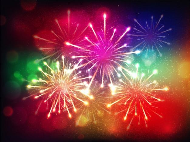 カラフルな花火は、お祝いのきらびやかな背景。 Premiumベクター