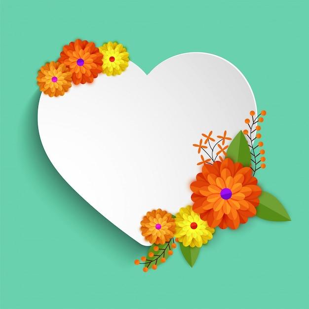 カラフルな花で飾られた白い紙の心。 Premiumベクター