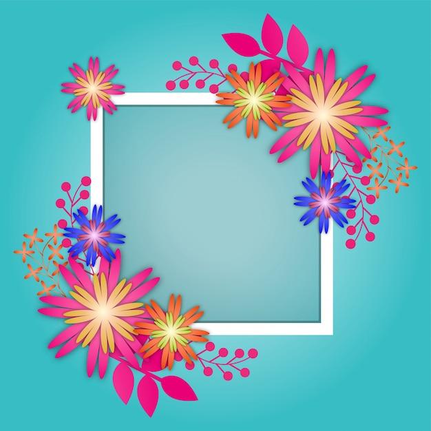 青い背景に白い四角い枠で紙の花。 Premiumベクター