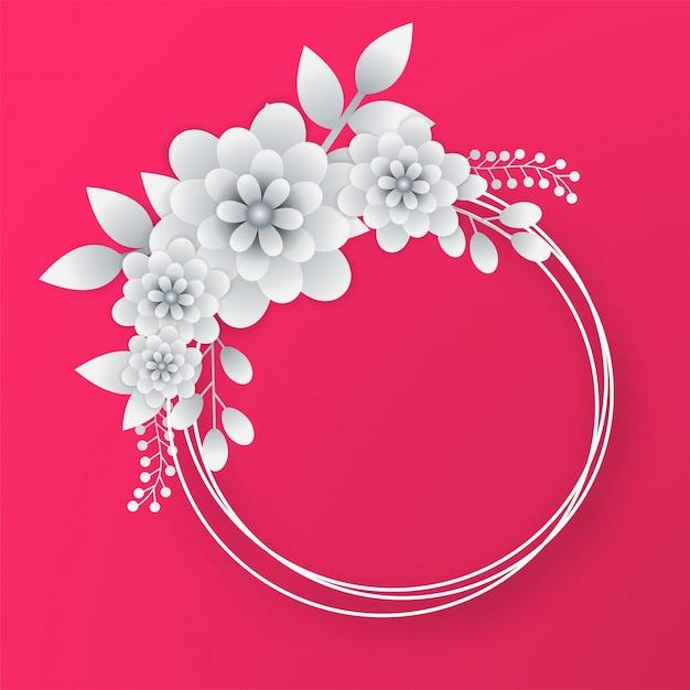 ピンクの背景に円形のフレームと白い紙の花。 Premiumベクター