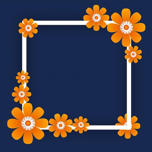 青い背景に正方形のフレームでオレンジ色の紙花。 Premiumベクター