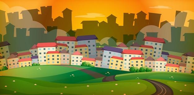 村の多くの家がある背景のシーン 無料ベクター