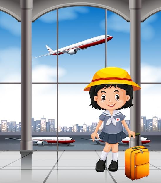 空港ターミナルの日本人女の子 Premiumベクター