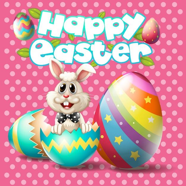 Счастливой пасхи с кроликом и яйцами на розовом фоне Бесплатные векторы