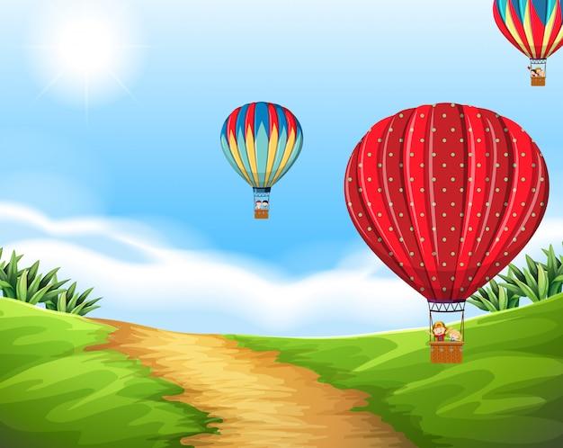 自然の風景の中の熱気球 Premiumベクター