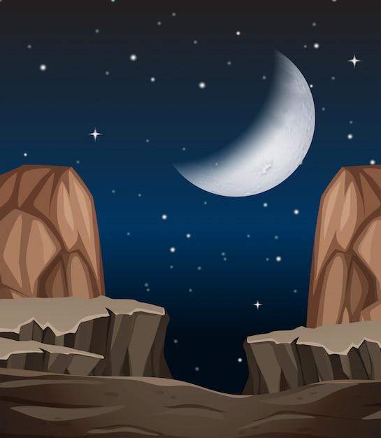 夜の石の崖のシーン Premiumベクター