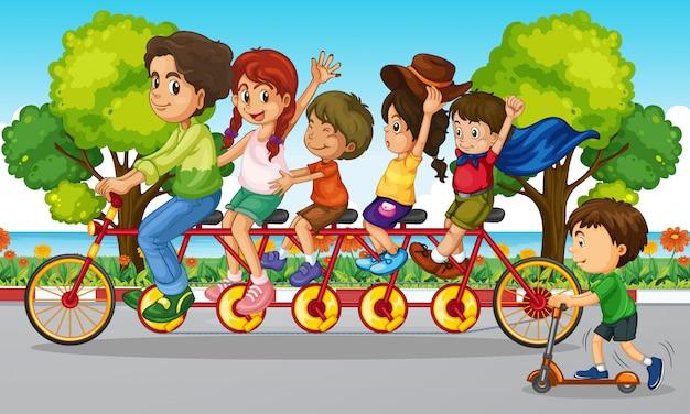 家族は公園で自転車に乗る 無料ベクター
