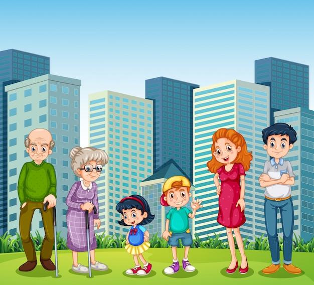 Семья с бабушкой и дедушкой перед зданием Бесплатные векторы