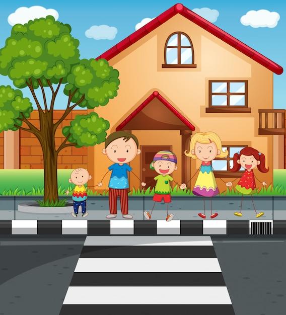 道路を横断しながら手を繋いでいる家族 無料ベクター