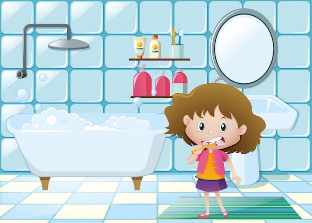 Маленькая девочка, чистящая зубы в ванной комнате Бесплатные векторы