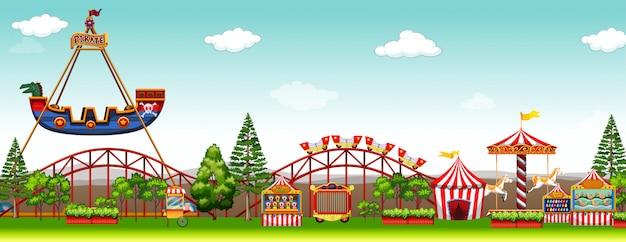 Парк развлечений с множеством аттракционов Бесплатные векторы