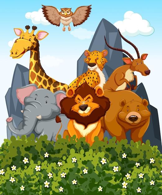 公園内にたくさんの野生動物がいるシーン 無料ベクター