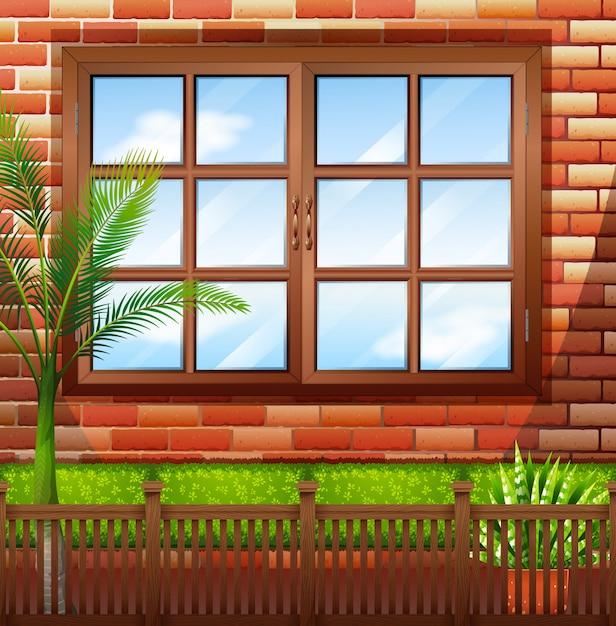 レンガの壁と窓のある建物の側面 無料ベクター