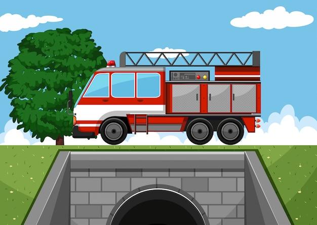 Пожарная машина на дороге Бесплатные векторы