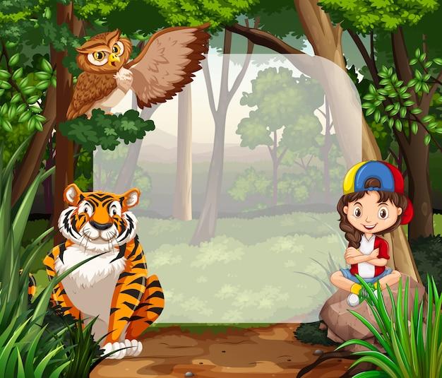 Маленькая девочка и дикие животные в джунглях Бесплатные векторы