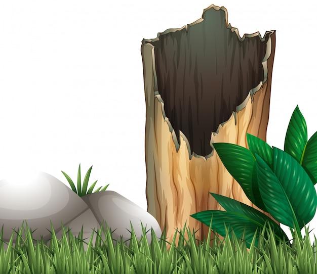 木の丸太と草原の岩 無料ベクター