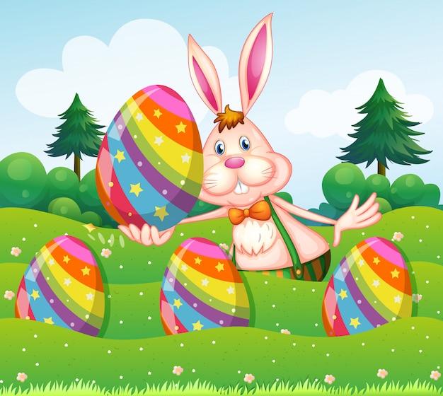 イースターのウサギと庭の卵 無料ベクター