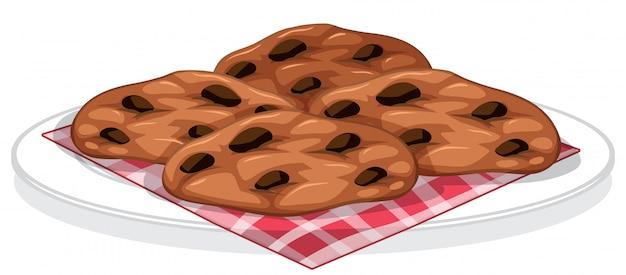 プレート上のチョコレートチップとクッキー 無料ベクター