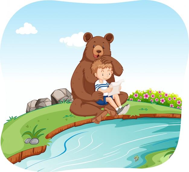 川でクマと座っている小さな男の子 無料ベクター