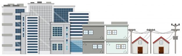 多くの建物と白い背景の上の家 無料ベクター