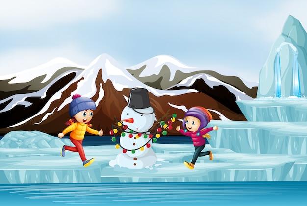 子供と雪だるまのシーン 無料ベクター