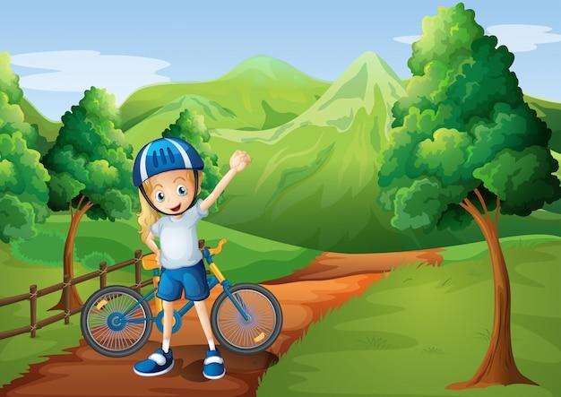 Милая маленькая девочка и ее велосипед на дорожке возле деревянного забора Бесплатные векторы