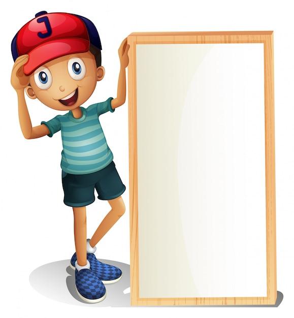 Молодой мальчик стоит возле пустой вывески Бесплатные векторы