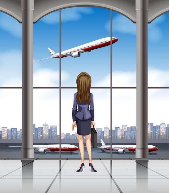 離陸する飛行機を見て女性 無料ベクター