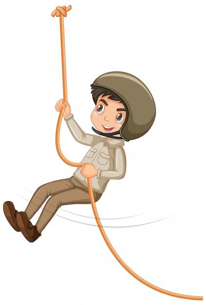 白い背景の上にロープを登るサファリ服の少年 無料ベクター