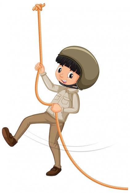 Мальчик в скаутской форме восхождение веревки на белом фоне Бесплатные векторы