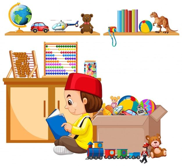 Сцена со множеством игрушек на полке и мусульманский мальчик, читающий книгу Бесплатные векторы