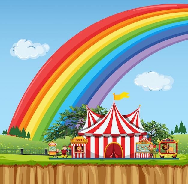 Цирковая сцена с радугой в небе Premium векторы