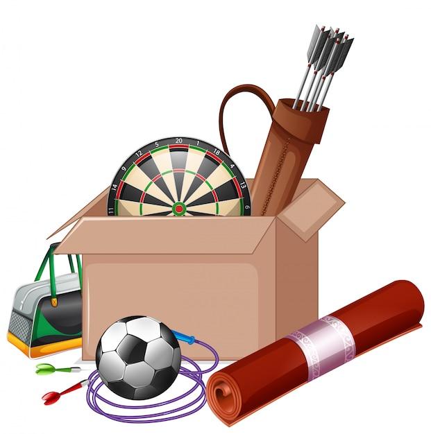 Картонная коробка, полная спортивного оборудования на белом Бесплатные векторы