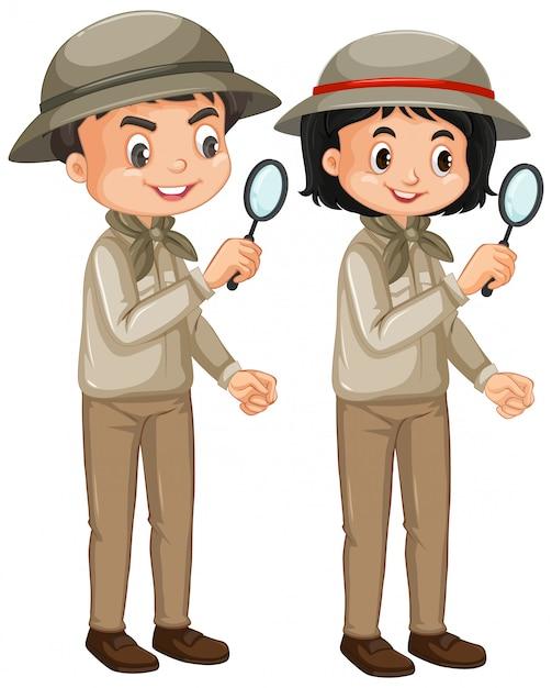 Мальчик и девочка в сафари наряд на белом Бесплатные векторы