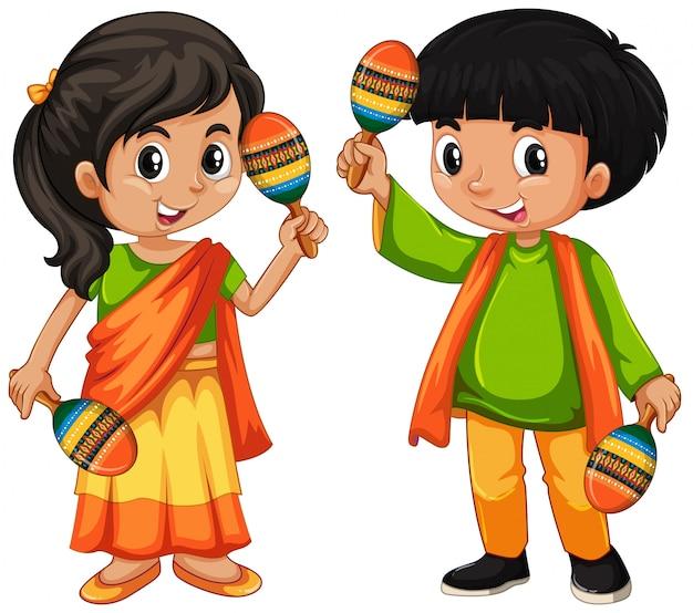白い背景の上にマラカスを保持しているインドの子供 無料ベクター