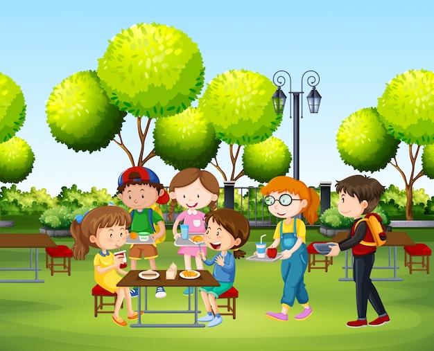昼間に公園で食べる人 Premiumベクター