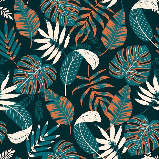 Красивая бесшовные модели с тропическими растениями и листьями Premium векторы