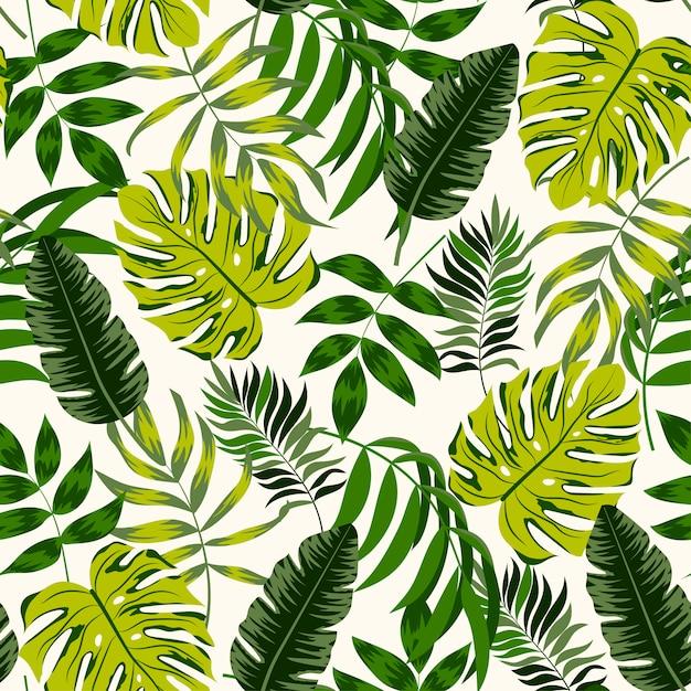 Тропический бесшовный фон с зелеными растениями и листьями Premium векторы