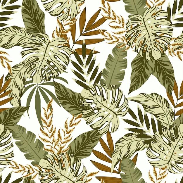 緑の植物と葉を持つ熱帯のシームレスパターン Premiumベクター