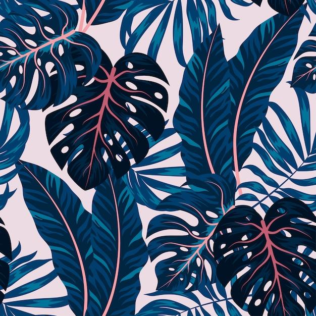 カラフルな植物と熱帯のシームレスパターン Premiumベクター
