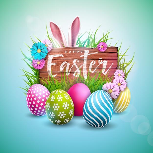 塗装卵とウサギの耳を持つハッピーイースターホリデーデザイン Premiumベクター