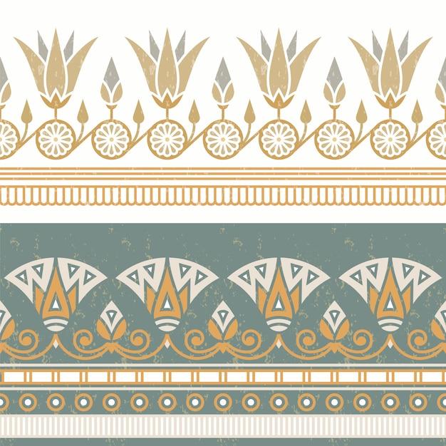 白い花を持つエジプトの国民の飾りのシームレスなパターン。 Premiumベクター